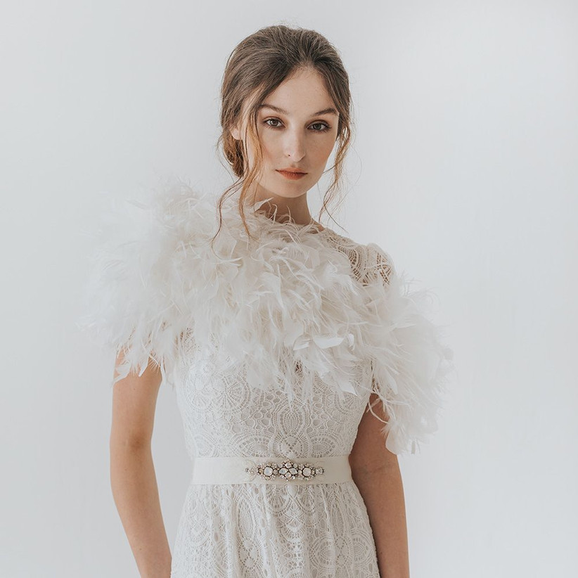 Model wearing a feather wedding stole