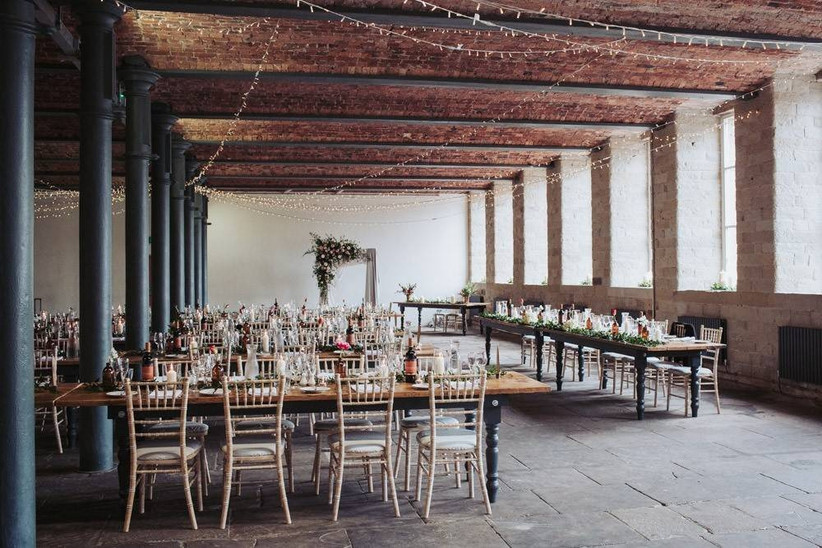 Wedding dining area in an industrial barn