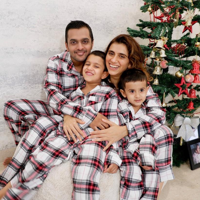 Family in matching Christmas pyjamas