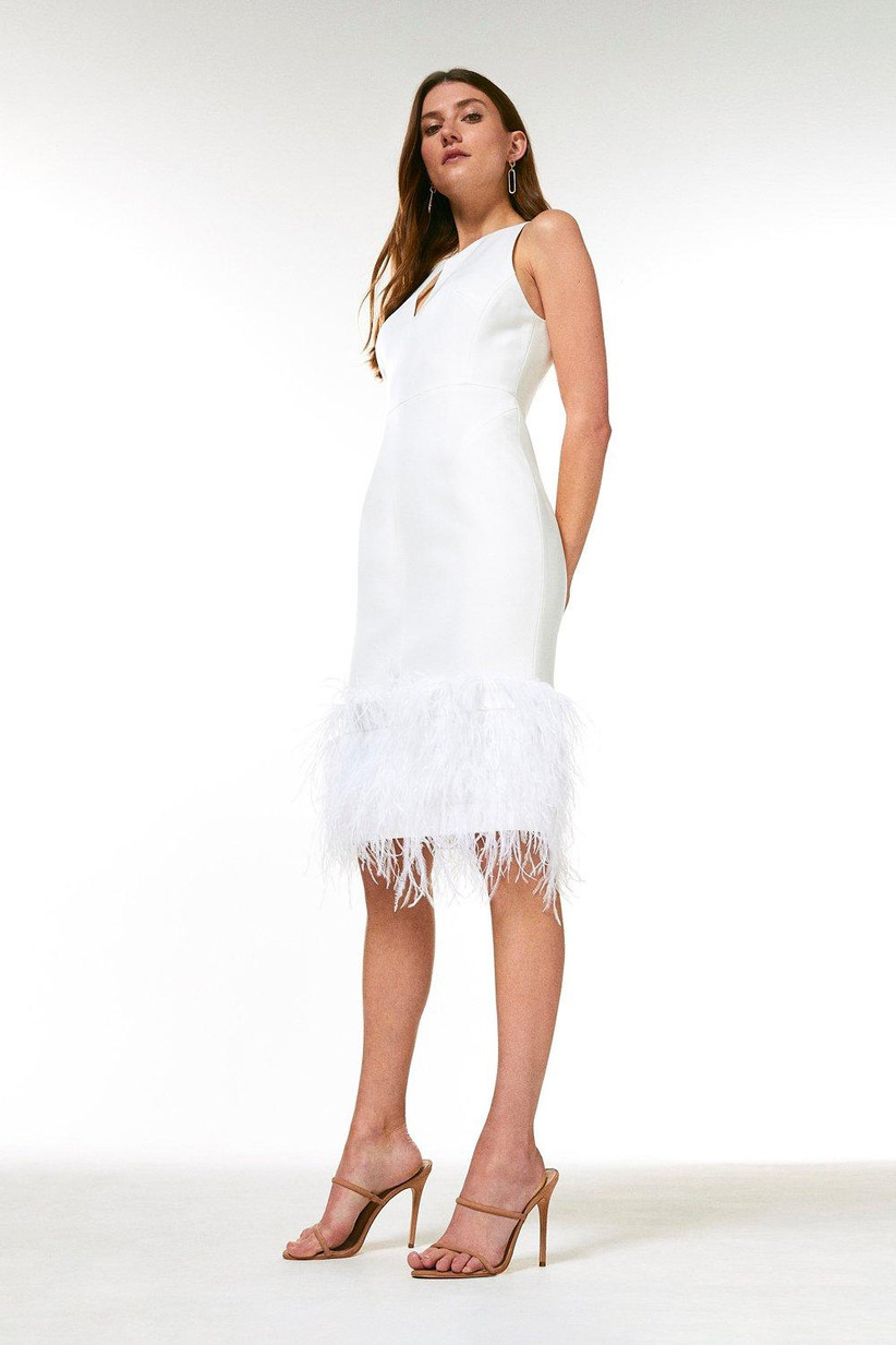 Model wearing a feather trimmed pencil dress