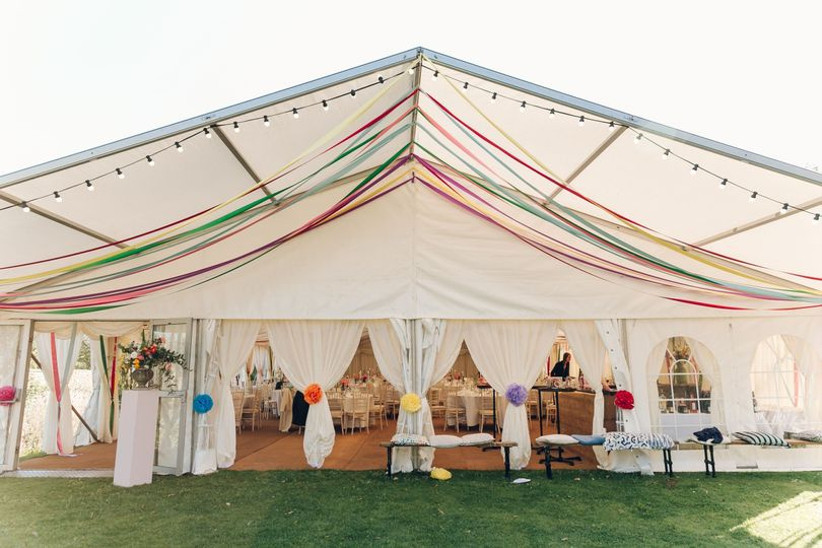Brightly decorated wedding marquee
