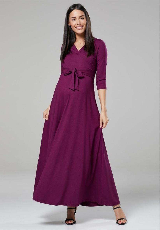 Pregnant model wearing a long sleeved purple wedding guest dress