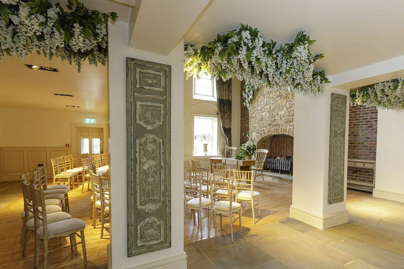 Wedding ceremony area with hanging white flowers