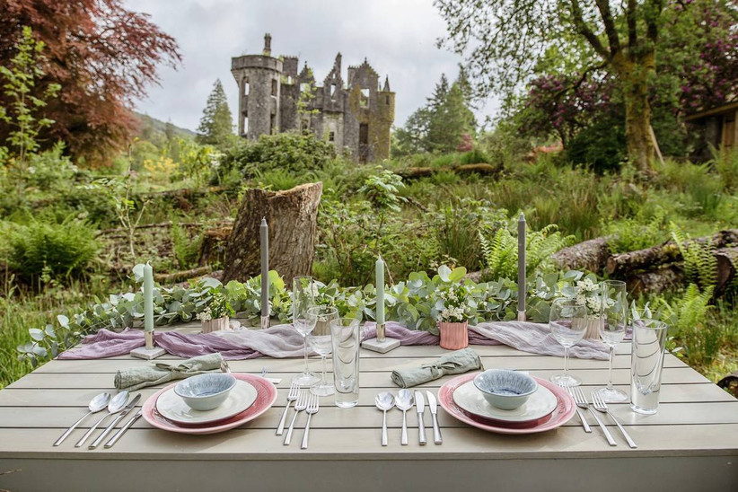 Dining table with a castle in the background