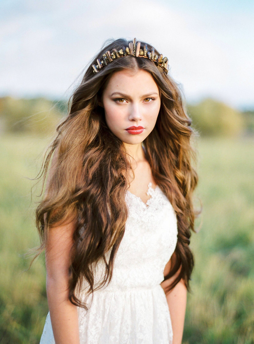 Model with tousled wavy hair and a jewel tiara