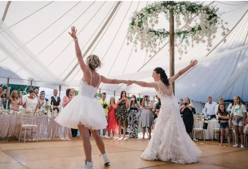 Brides dancing in a wedding marquee