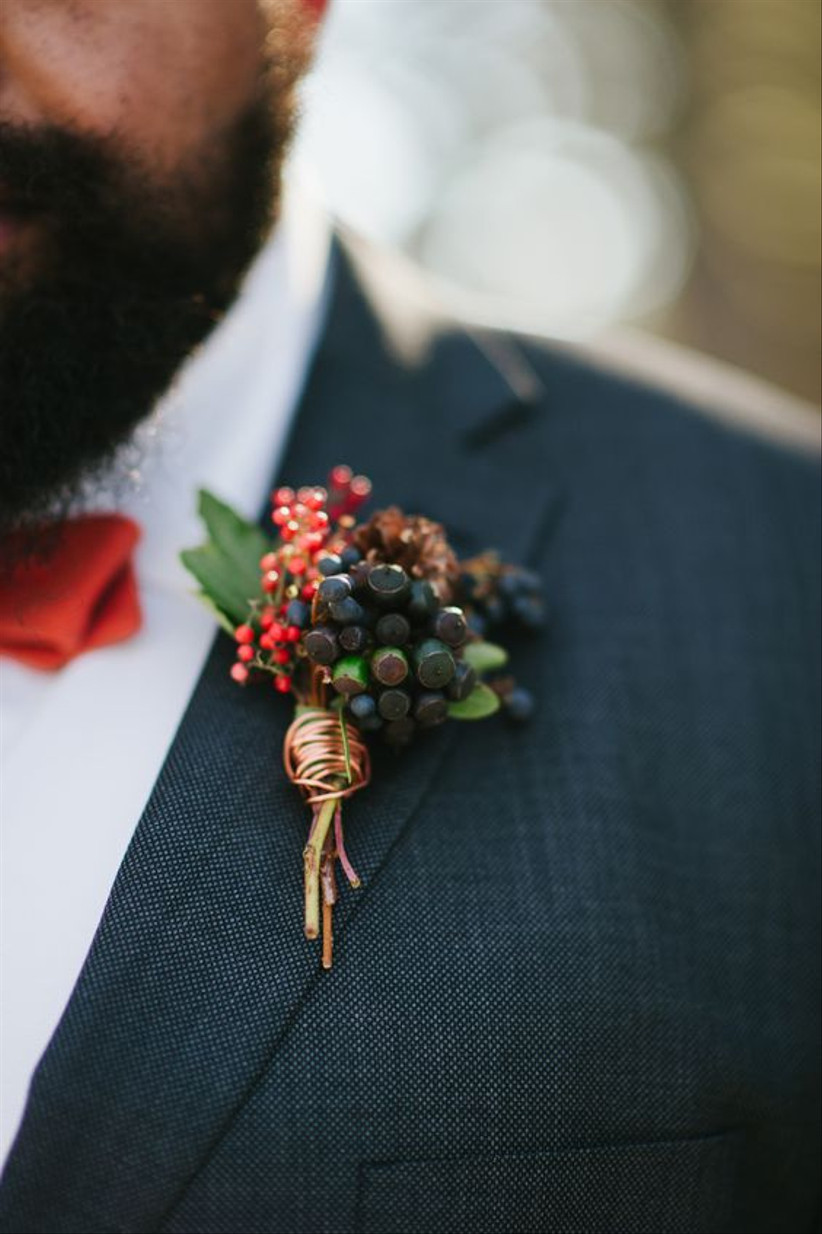 Groom wearing a berry wedding buttonhole