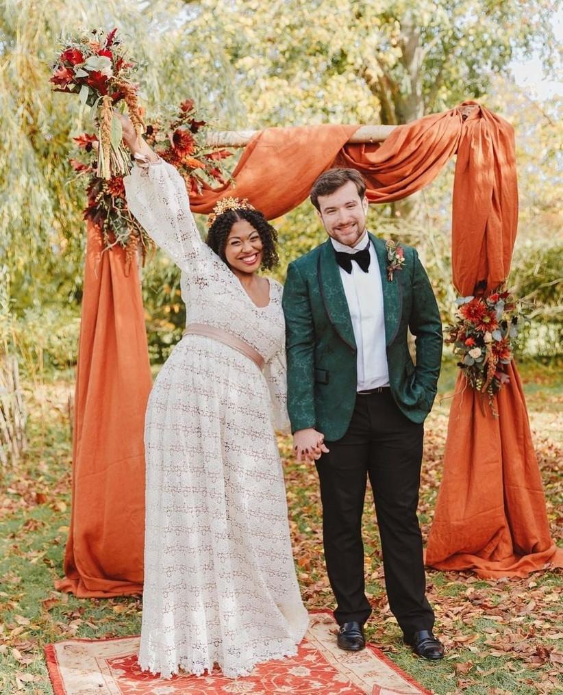 Happy couple at autumn themed wedding