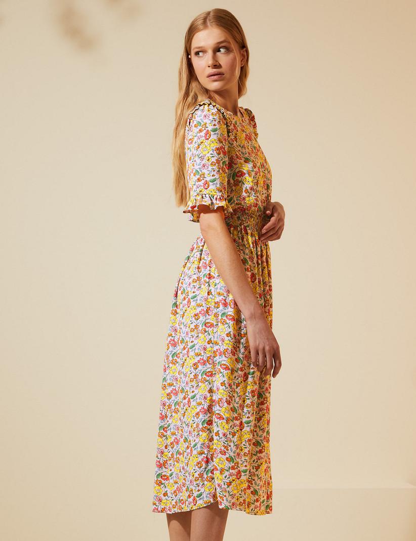 Model wearing midi tea dress