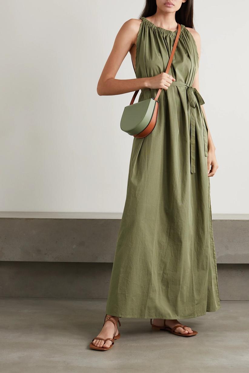 Model wearing a green wedding guest dress