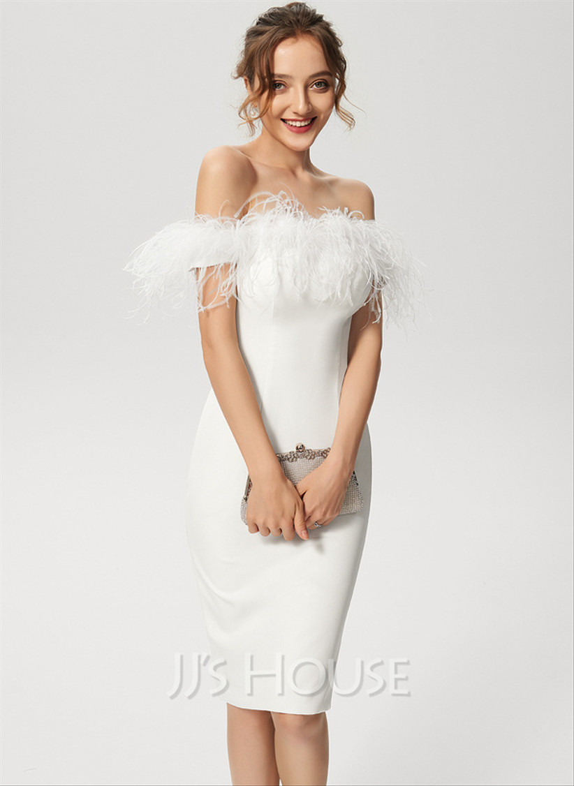 Model wearing a column off the shoulder feather wedding dress