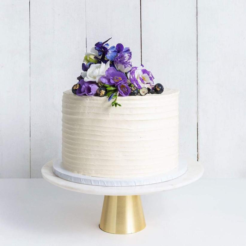 Single tier wedding cake with purple flowers