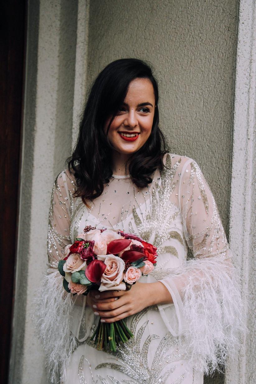 Bride holding a winter wedding bouquet