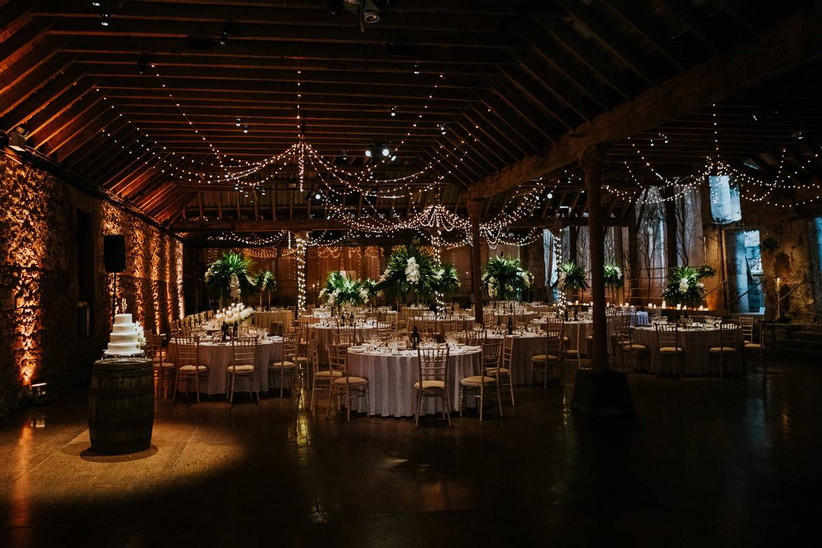 Wedding dining area decorated with fairy lights