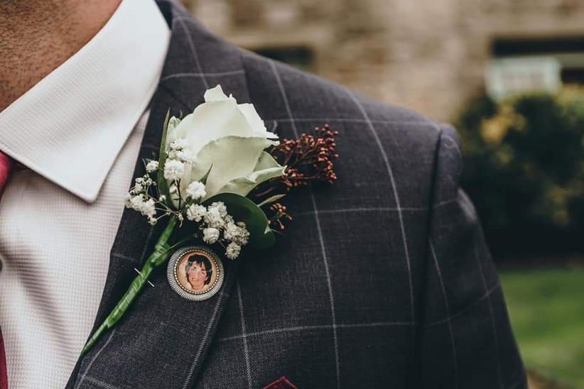 Groom wearing a sentimental wedding buttonhole