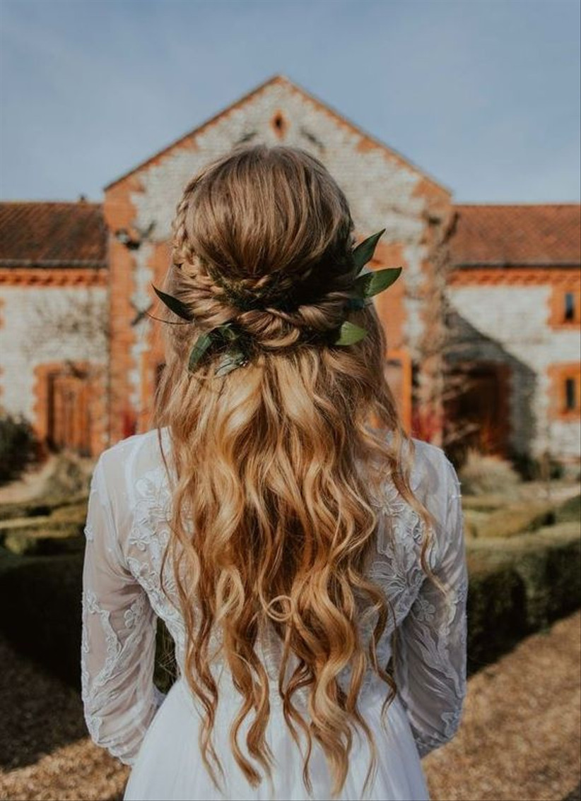Model with a greenery entwined half up half down hairstyle