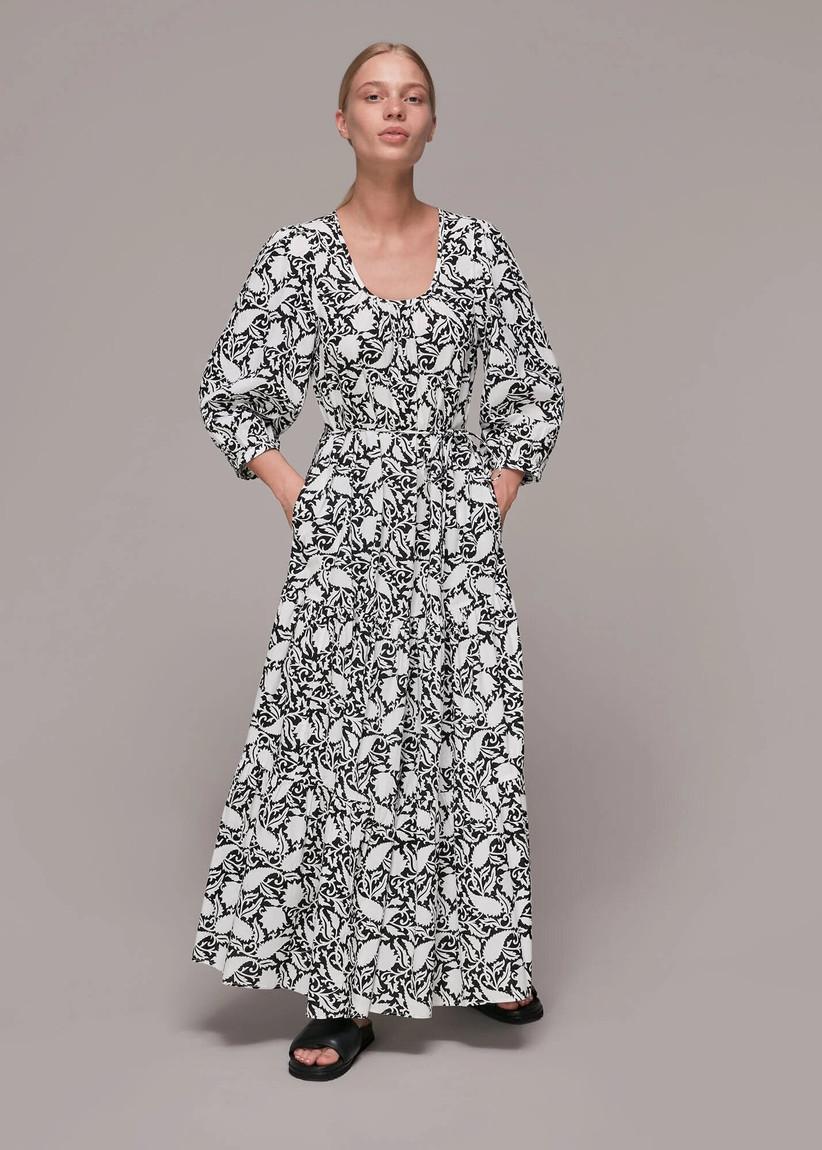 Model wearing a monochrome floral trapeze wedding guest dress