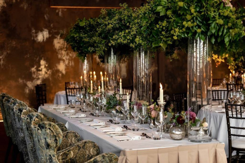 Wedding table with greenery and candles
