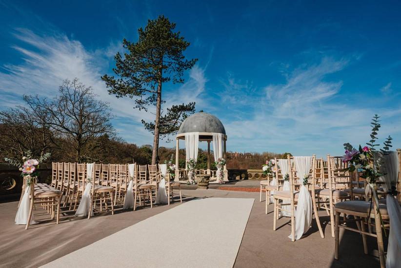 Outside wedding ceremony area with a gazebo