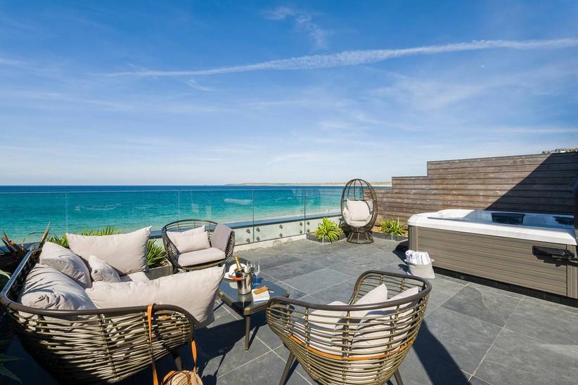 Coastal wedding venue balcony with a hot tub