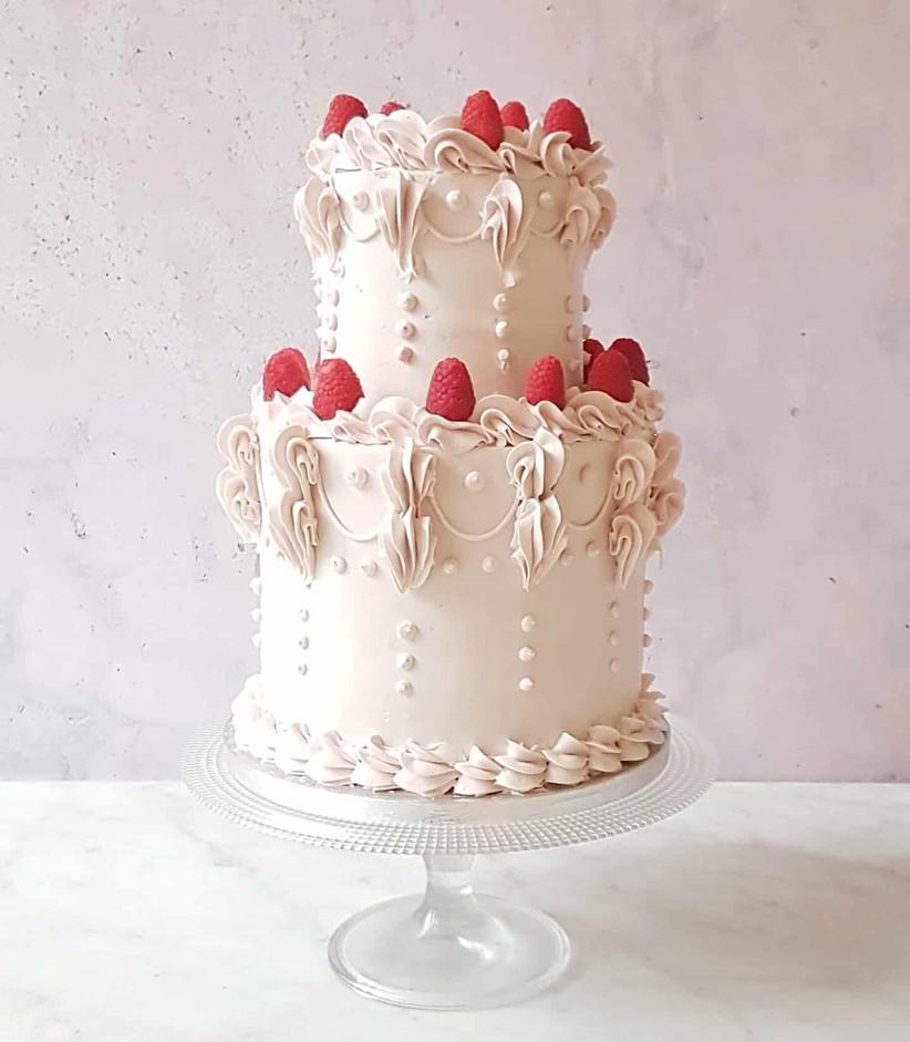 Light pink cake with fresh raspberries