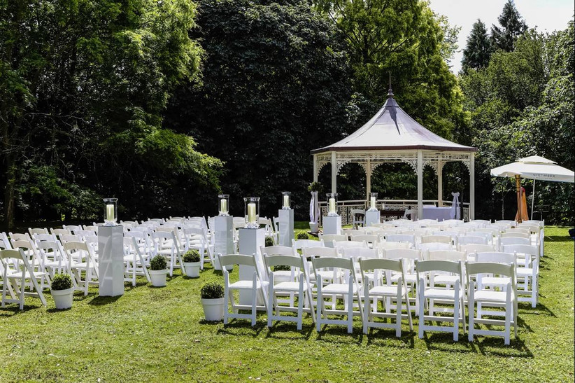 Outside wedding ceremony with a pavilion