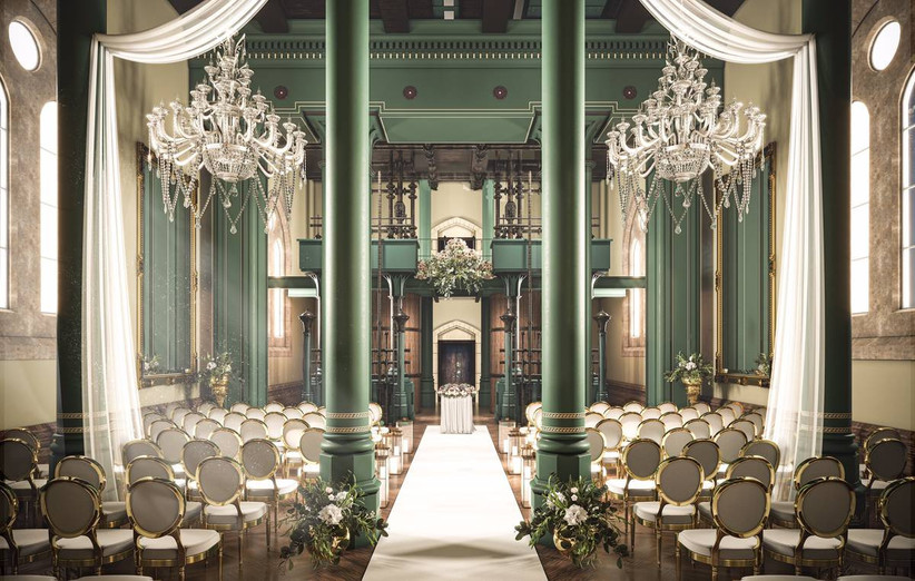 Grand wedding ceremony room with columns and chandeliers