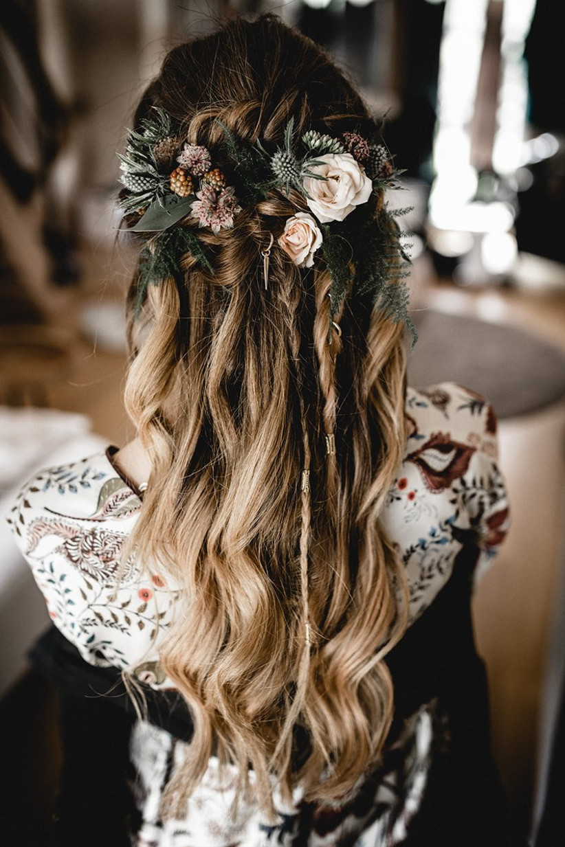 Model with floral plaits and charms hairstyle