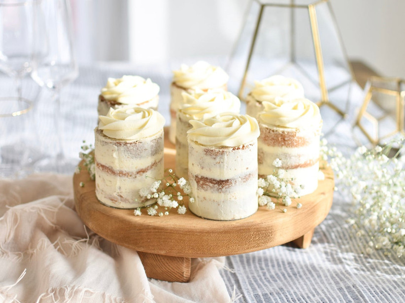 Mini cakes on a wooden wedding cake stand