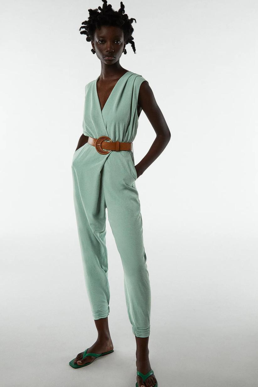 Model wearing a pale green sleeveless jumpsuit