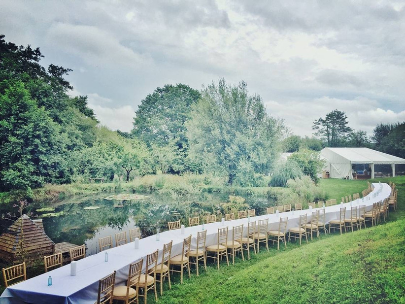 Wedding chairs alongside a lake