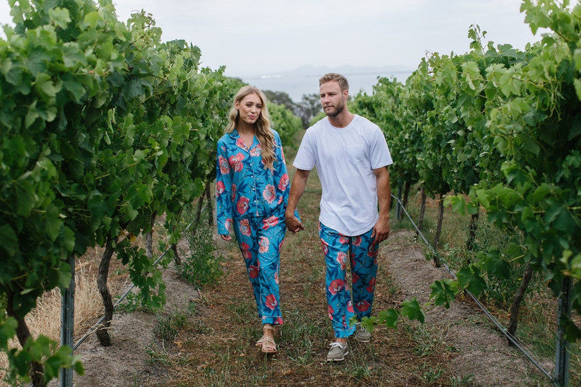 Couple holding hands in matching pyjamas