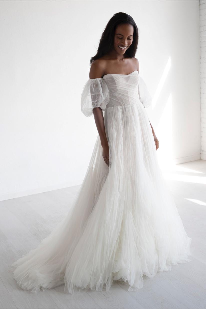 Model wearing a short sleeve puff wedding dress