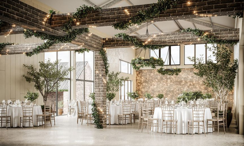 Wedding dining area with green garlands
