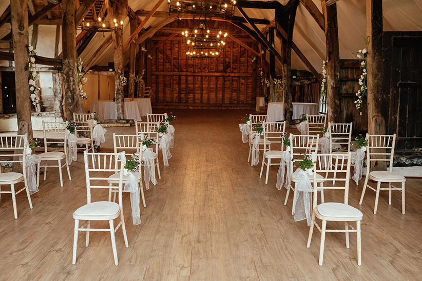Wedding ceremony set up with white chairs placed two metres apart