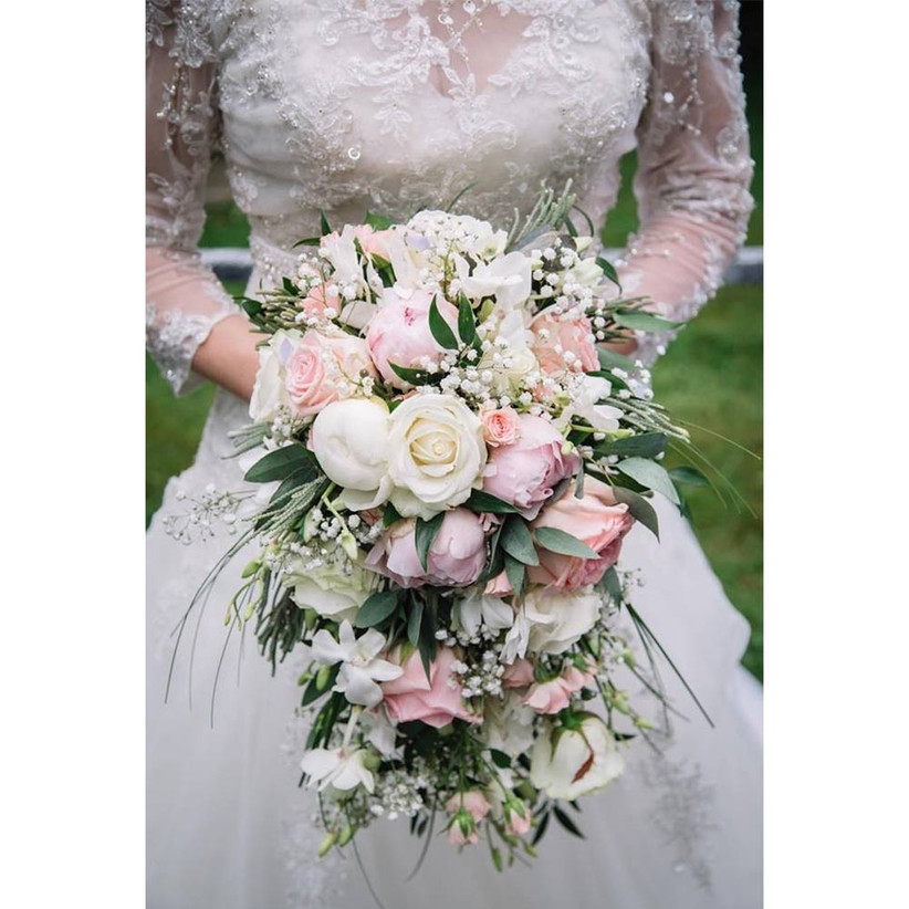white-and-peach-cascading-wedding-bouquet