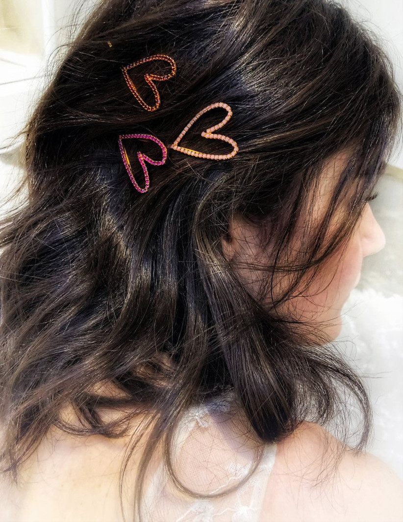 Side sweep hair style with heart rhinestone clips