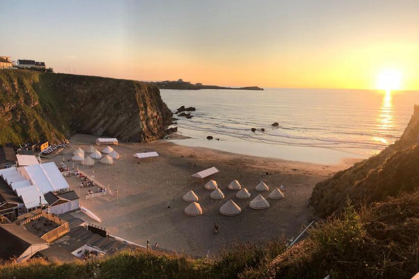 Outdoor wedding venue Lusty Glaze beach at sunset