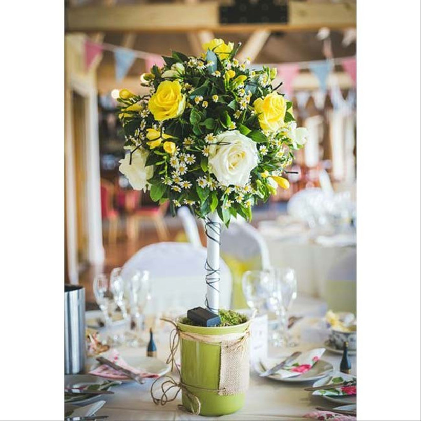 a-centrepiece-filled-with-seasonal-wedding-flowers-like-this-one-that-has-accents-of-yellow-would-be-ideal-for-a-spring-wedding