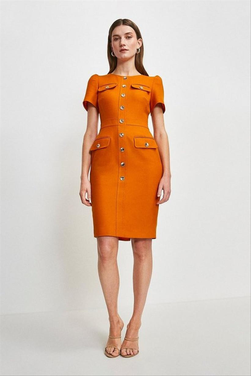Girl wearing an orange utility pencil dress