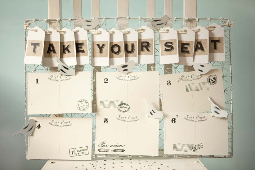 shabby-chic-table-plan-from-wedding-in-a-teacup