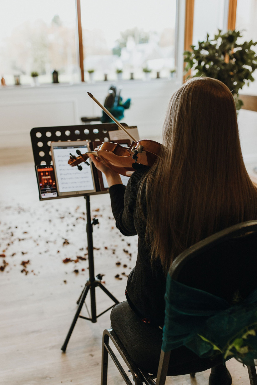 A violinist playing at Michelle and Jonathan's blessing ceremony