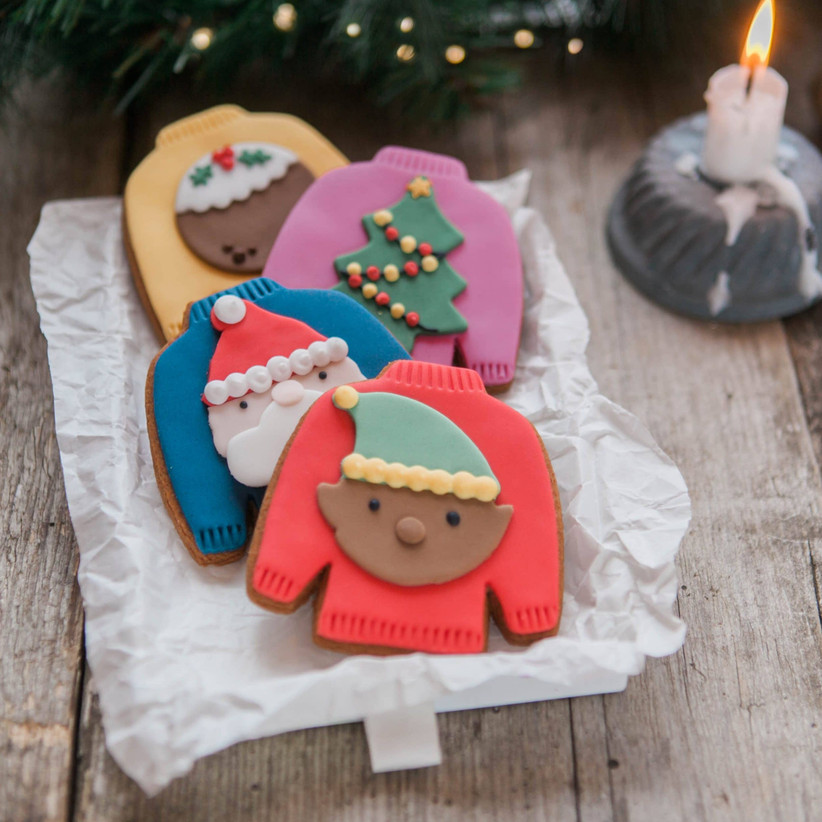 Beautifully decorated Christmas jumper biscuits