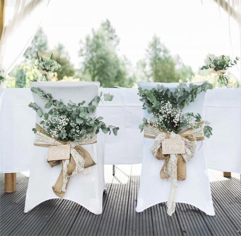 wedding-chairs-decorated-with-flowers-and-hessian