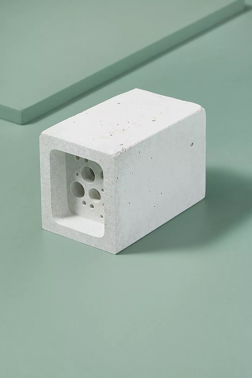 White brick style bee block against a light green background