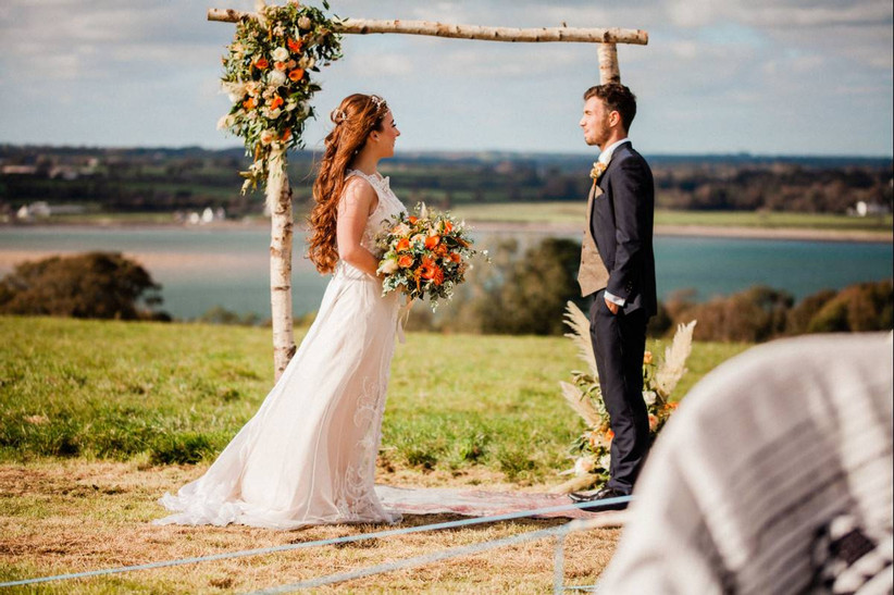 Bride and groom in an outside field ceremony