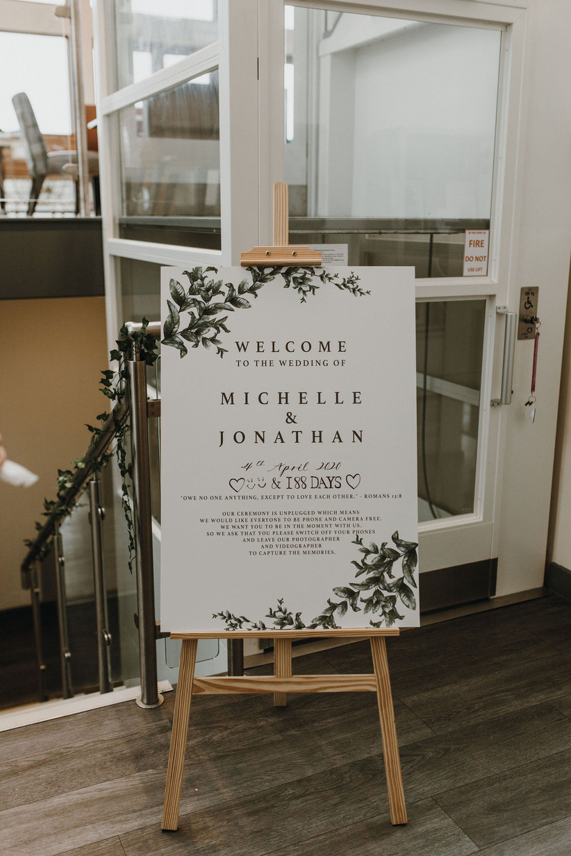 The green and white wedding welcome sign