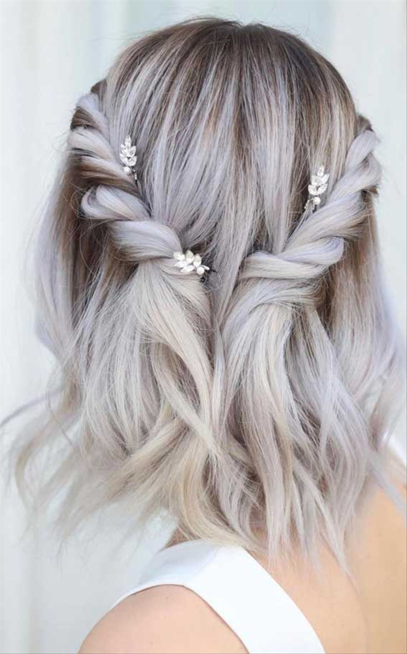 Short silver hair with side twists and crystal clips
