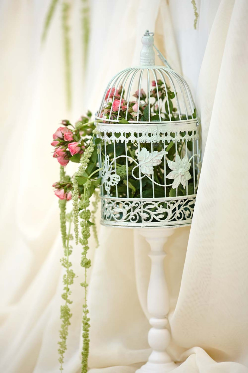 a-great-spring-wedding-idea-is-to-fill-a-birdcage-with-seasonal-wedding-flowers-for-a-vintage-touch