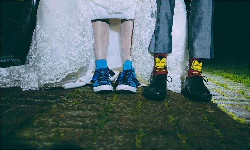 bride-and-groom-showing-off-their-footwear-2